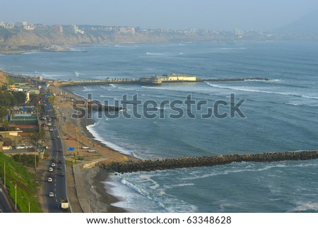 The seaside road in Miraflores, with a view on the coastline of Southern Lima in the usual misty weather. The surf breaks are used by many tourists and locals for surfing - stock photo