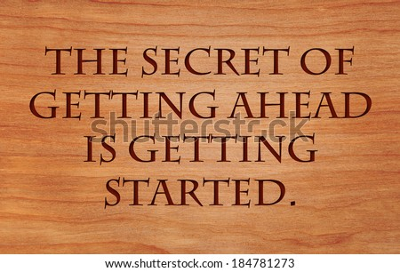 The secret of getting ahead is getting started - motivational quote by Mark Twain on wooden red oak background - stock photo