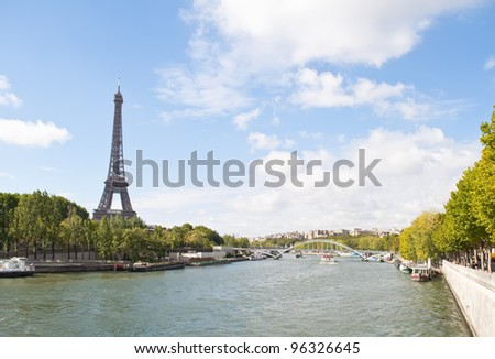 The Seine River passing by the Eiffel Tower in Paris, France - stock photo