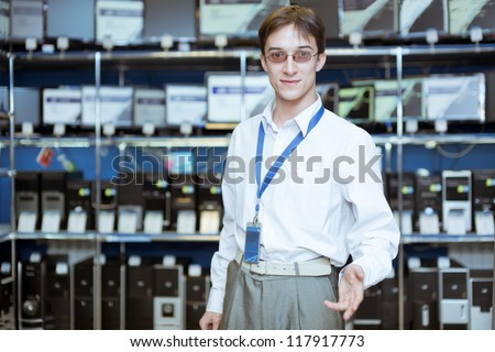 The seller-adviser on a background of computer monitors - stock photo