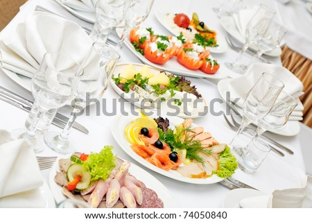 The served dinner table in a restaurant. - stock photo