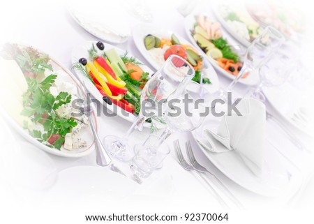 The served dinner table in a restaurant. High key. - stock photo