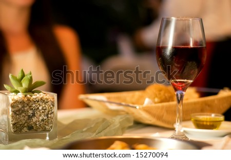 The served table with red wine at restaurant (shallow dof) - stock photo
