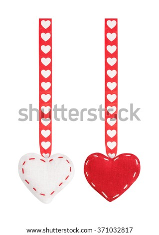The set from red two textile hearts hanging on a ribbon with a pattern from hearts for St. Valentine's Day isolated on the white - stock photo