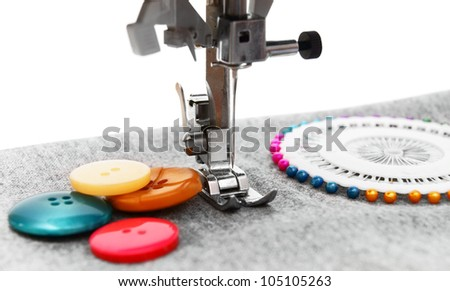 The sewing machine, buttons and needles. - stock photo