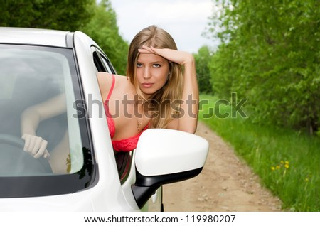 The sexual girl in bikini with car - stock photo