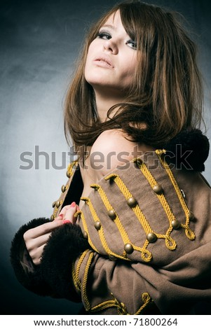 The sexual young woman in a suit of the hussar. - stock photo