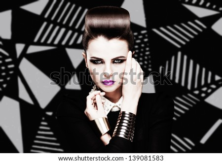 the sexy strict woman with violet lips and a fashionable  hairstyle poses in studio on creative background - stock photo