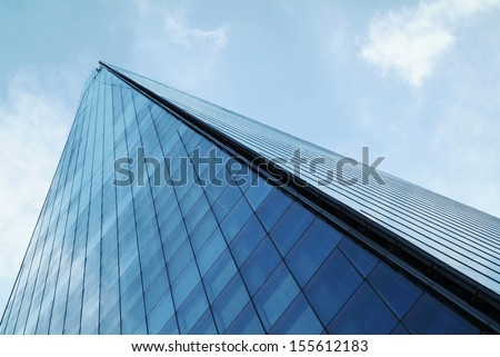 The Shard towering over London, photographed in London, UK. Built in 2012 and standing 306 meters tall, the Shard is currently the tallest building in the European Union and a new London attraction. - stock photo