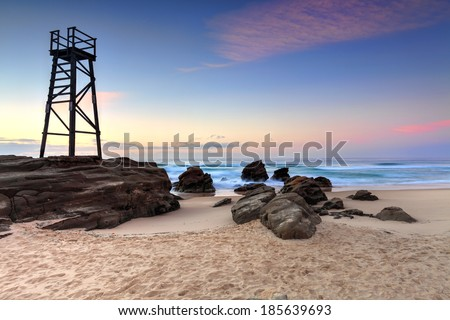 The Shark Tower and jagged rocks at Redhead Beach, NSW Australia - stock photo