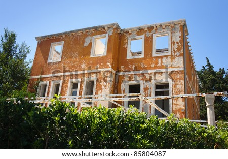 The shell of an abandoned house - stock photo