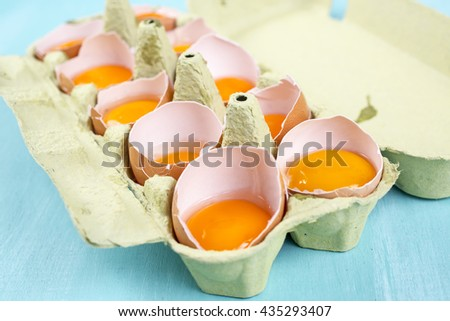 the shell of an egg with yolk - stock photo