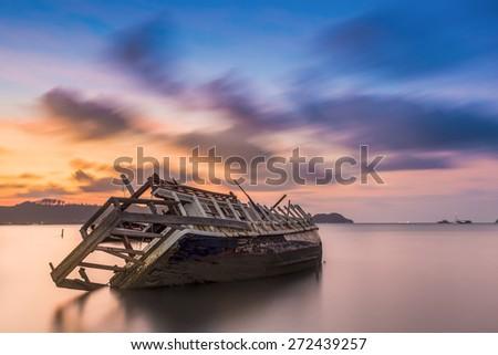 The ship capsized sunrise Phuket thailand  - stock photo