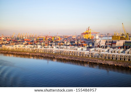 The ship sails past the cargo terminal.  - stock photo