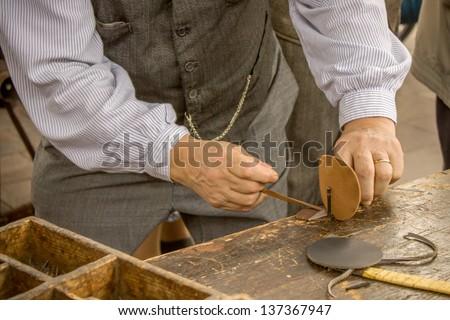 The shoe-maker - stock photo