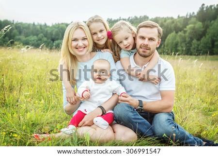 The shot of happy family outdoors - stock photo
