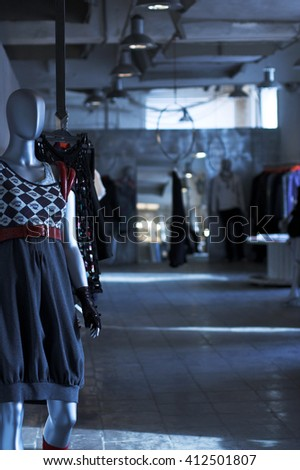 The show-room of modern clothing shop - stock photo