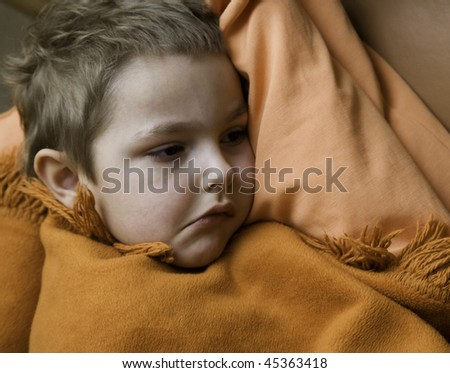 The sick child is in bed - stock photo