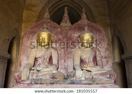 The side by side buddhas (historical and future) inside Dhammayangyi temple Bagan - Myanmar - stock photo