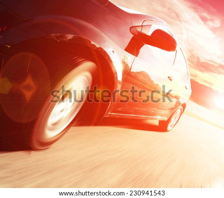 The Side view of black car in turn - stock photo