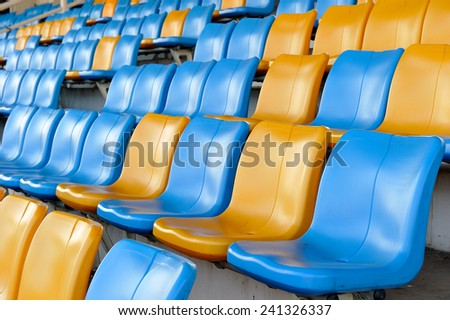 the side view row of seats on the stadium - stock photo