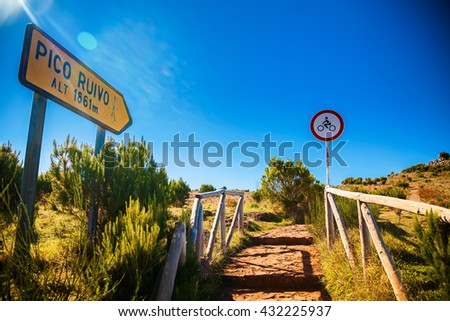 the sign and walking path to Pico Ruivo, highest peak of Madeira island, Portugal - stock photo