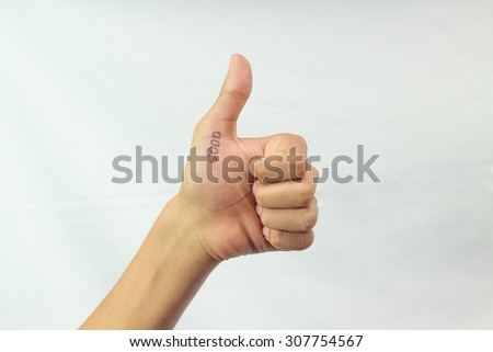 The sign from fingers of a hand. Lake. Good. - stock photo
