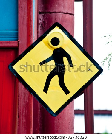 The sign of warning walk across the road - stock photo