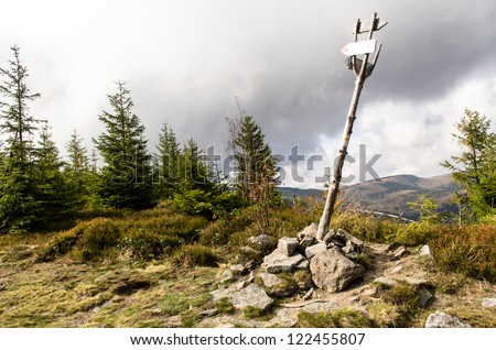 the signpost on a mountain trail. Beskidy, Poland - stock photo