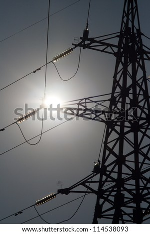 The silhouette of electricity pylon - stock photo