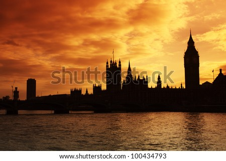 The silhouette of Westminster and the Houses of Parliament at sunset - stock photo