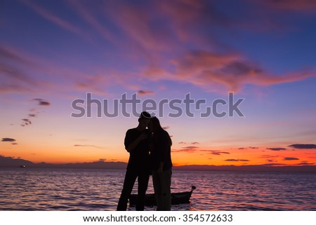 The Silhouettes are doing Activities on the Beach at Sunset - stock photo