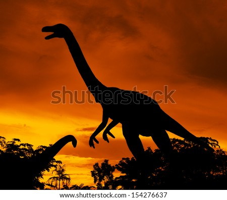 the silhouettes of dinosaurs - stock photo