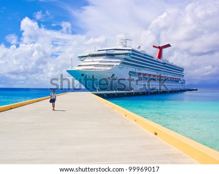 The single female tourist and a big passenger ship in port. - stock photo