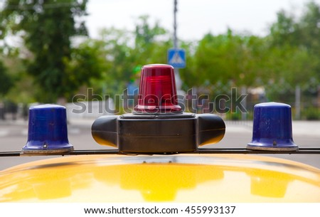 The siren and flashing beacons on the roof of a police car - stock photo