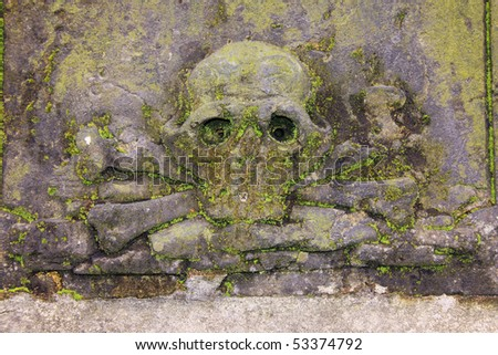 The Skull and Crossbones on the Tomb on the old Prague Cemetery - stock photo