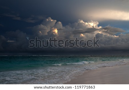 The sky above ocean before storm - stock photo