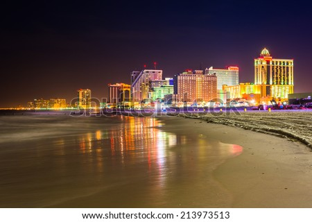 The skyline and Atlantic Ocean at night in Atlantic City, New Jersey. - stock photo