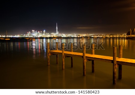 The skyline of  Auckland , New Zealand at night. - stock photo