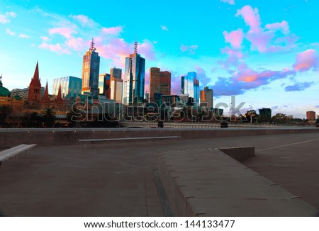 The skyline of Melbourne and the Princess Bridge at dusk. Photographed from the Southbank Promenade along the Yarra River. - stock photo