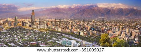 The skyline of Santiago in Chile. Photographed from Cerro San Cristobal at sunset. - stock photo