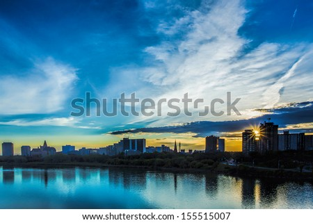 The skyline of Saskatoon, Canada at sunset. - stock photo