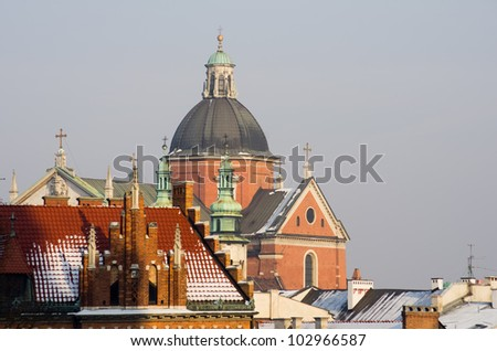 The skyline of the city of Krakow in Poland in winter. View from Wawel Castle to the dome of St. Peter and St. Paul Church. - stock photo