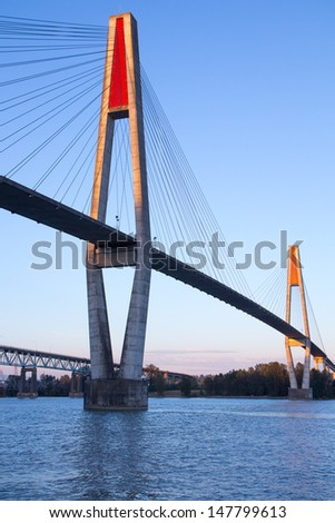 The skytrain transit bridge over the Fraser River in New Westminster, British Columbia, Canada - stock photo
