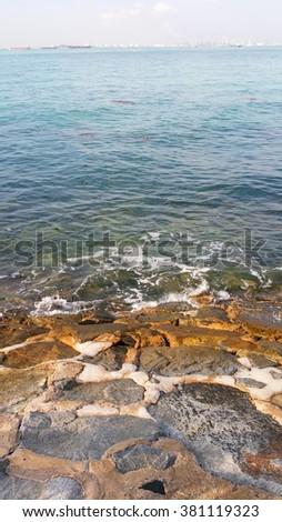 The slope near the sea is covered and cemented with rocks. This rocky bed can withstand constant blows by strong wave current and long period soaking in sea water during high tide. - stock photo