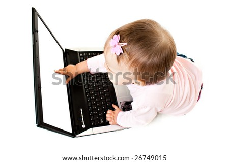 The small baby with the computer on a white background - stock photo