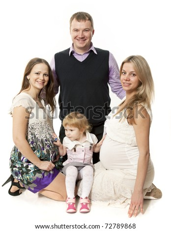 The small group, two pregnant women, the child, and the man - stock photo