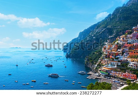 The small haven of Positano village with the tiny beach and colorful houses, located on the rock, Amalfi coast, Italy. - stock photo