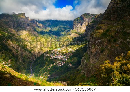 the small town Curral das Freiras surrounded by mountains, Madeira, Portugal - stock photo