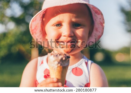 The Smile Of A Little Girl Smeared With Ice Cream - stock photo